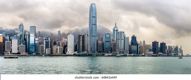 Panoramic view of the towers of Hong Kong under a stormy sky