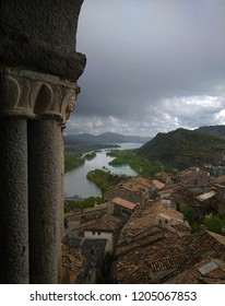 Panoramic view of the town of Aínsa and its reservoir from the bell tower of the Romanesque church of Ainsa, Huesca (Spain).