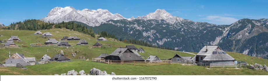 Panoramic view of traditional cottages on Velika planina (Big Pasture Plateau) in front of Kamnik-Savinja Alps