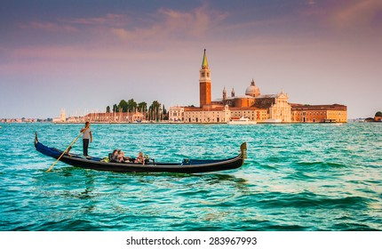Panoramic view of traditional Gondola on Canal Grande with San Giorgio Maggiore church in the background in beautiful evening light at sunset, San Marco, Venice, Italy
