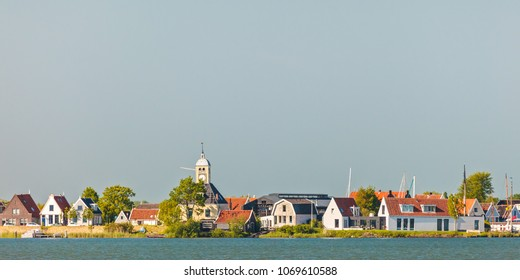 Panoramic view of traditional wooden houses in the small Dutch village of Durgerdam