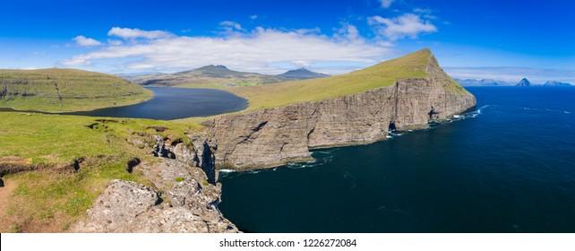 Panoramic View Of The Traelanipan Cliff And Sorvagsvatn Lake at Sunny Day, Vagar, Faroe Islands, Denmark.  - A Lake Above the Ocean