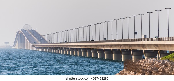 Panoramic view of traffic crossing the highest point of the King Fahd Causeway bridge between Saudi Arabia and Bahrain seen from the Causeway Island looking towards Saudi Arabia.