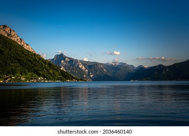 Panoramic view of Traunsee lake during sunset, landscape photo of lake and mountains near Gmunden, Austria