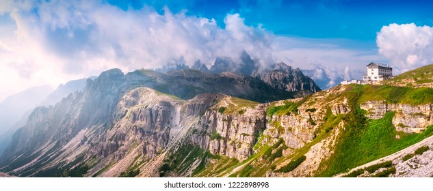Panoramic view from Tre Cime di Lavaredo and alpine hut. Dolomiti Italian Alps, Veneto, Italy, Europe.
