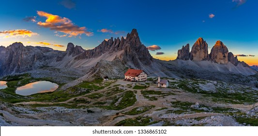 Panoramic view of  Tre Cime and  rifugio hut before sunrise, Tre Cime di Lavaredo National Park, Dolomites, Italy