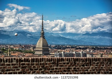 Panoramic view of Turin city center, in Italy, in a sunny day, with Mole Antonelliana and Alps in the background