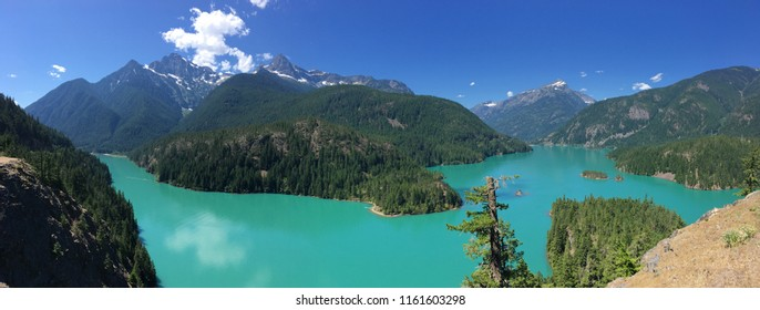 Panoramic view of a turquoise lake in the Cascade mountains in Washington State