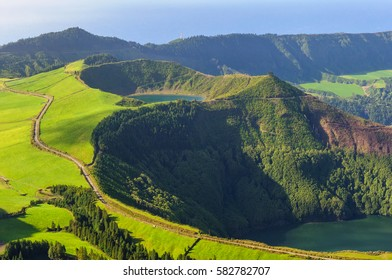 Panoramic view of two crater lakes Lagoa de Santiago and Lagoa Rasa at volcanic massif of Sete Cidades in western region of Sao Miguel Island, Azores, Portugal