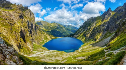Panoramic view of two lakes, Morskie Oko and Black lake, in polish Tatra mountains National park in Zakopane, Poland - Shutterstock ID 1654887865