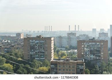 Panoramic view of typical multi-storey residential buildings with numerous wires above them