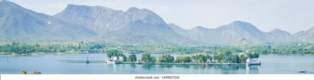 Panoramic view of Udaipur lake Fateh Sagar with mountains
