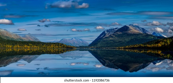 Panoramic View of Upper Trail Lake and Kenai Mountains with sky and mountains reflected near Moose Pass and Cooper Landing, Alaska