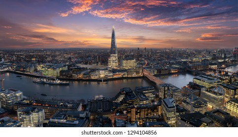 Panoramic view to the urban skyline of London, UK, along the river Thames just after sunset time