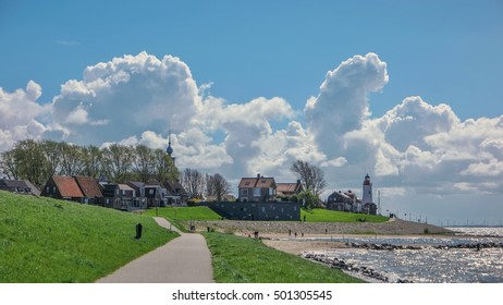 panoramic view at Urk a small fishing village at the lake ijsselmeer Netherlands Flevoland region 2016, beautiful white cloud pattern over the village of Urk Netherlands