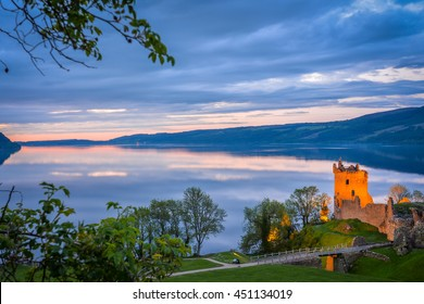 Panoramic view of Urquhart Castle. The castle sits beside Loch Ness, near Inverness and Drumnadrochit, in the Highlands of Scotland. Only the tower of the castle is in focus; the rest is blur.