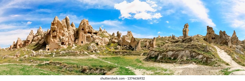 Panoramic view of the valley in Goreme village, Turkey on a sunny day. Rural Cappadocia landscape. Volcanic mountains in Goreme national park. Countryside lifestyle.