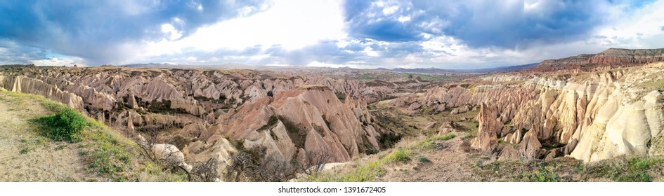 Panoramic view of the valley in Goreme village, Turkey. Rural Cappadocia landscape. Volcanic mountains in Goreme national park. Countryside lifestyle.