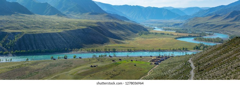 Panoramic view of the valley of the Katun river on an autumn morning, a cluster of Argut in the Altai Republic
