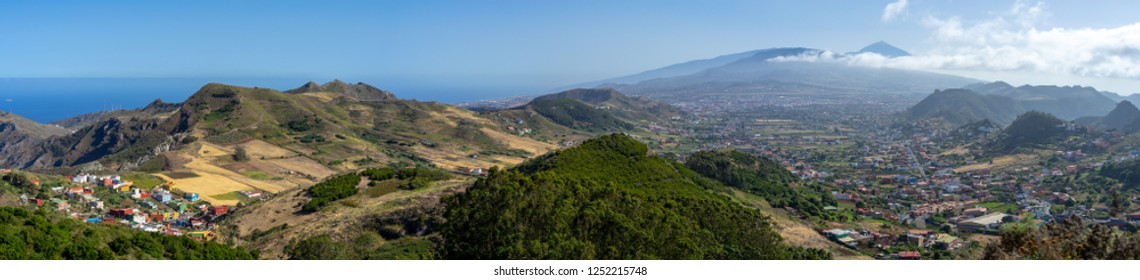 Panoramic view of the valley, the old capital of the island of San Cristobal de La Laguna and the volcano Teide. Tenerife. Canary Islands. Spain. View from the observation deck - Mirador De Jardina.