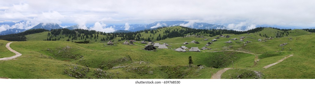 Panoramic view of Velika Planina and mountain cottage hut or house