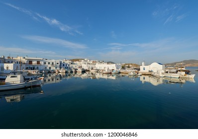 Panoramic view of venetian harbor at Naousa whitewashed houses and fishing boats