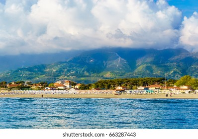 Panoramic view of Versilia coast at sunset with riviera resorts and Apuan Alps in background, Versilia, Tuscany, Italy.