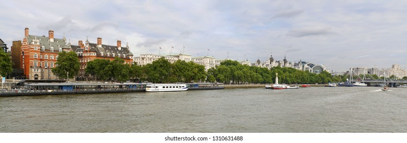 Panoramic view of Victoria Embankment in London, United Kingdom seen across Thames