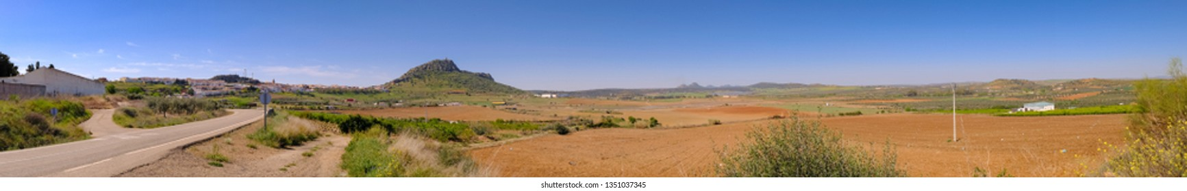 Panoramic view of the village of Alange with its castle on top of the mountain, next to the marsh of the same name, locality famous for its Roman baths and located Very close to the city of Merida.