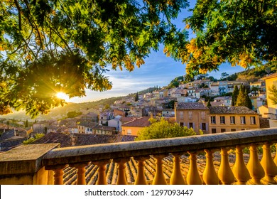 Panoramic view of the village Bormes-les-Mimosas from the terrace. Mimosa trees in bloom. Sunset. Provence, France.