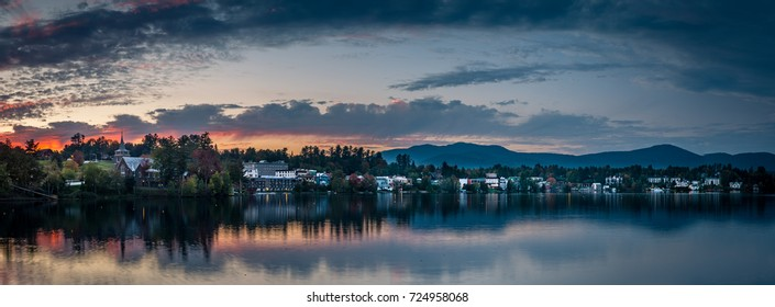 A panoramic view of the village of Lake Placid as seen from across Mirror Lake at sunset