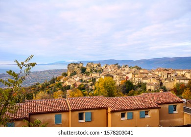 Panoramic view of the village of Saignon in autumn, Provence, Luberon, France. Snow-capped Mont Ventoux in the background.