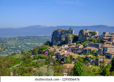 Panoramic view of the village Saignon in spring. Mont Ventoux in the background. Provence, France.