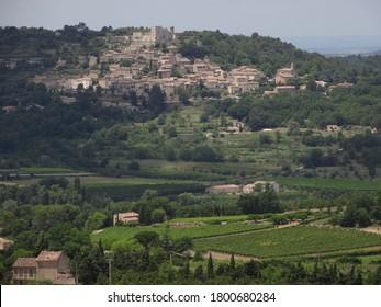 Panoramic view ,vineyards At Luberon , Lacoste village background