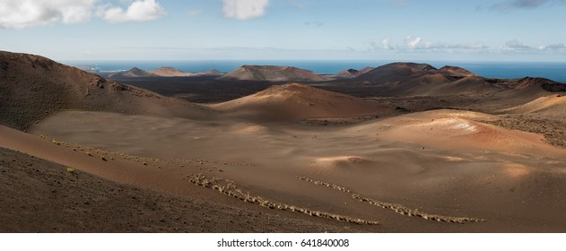 Panoramic view of volcanic landscape at Timanfaya National Park, Lanzarote, Spain