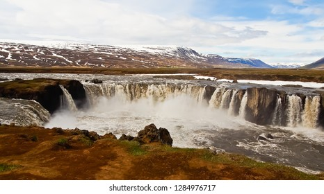 panoramic view of waterfalls from eastern bank of godafoss iceland