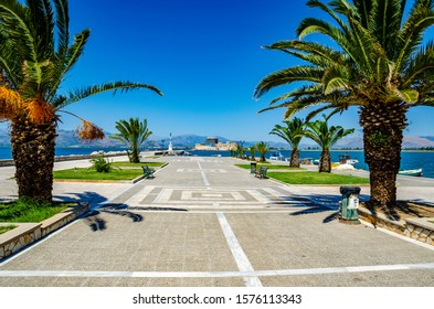 Panoramic view from the waterfront of the coastal city of Nafplio. Beautiful Spring colors around the picturesque port of Nafplio city, Greece
