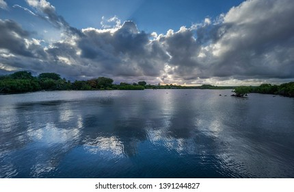 Panoramic view of a waterway with clouds reflection at dusk,  Poste de Flacq, Mauritius