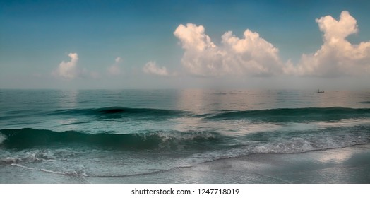 Panoramic view of waves breaking on shore