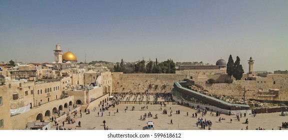 Panoramic view of Western Wall (aka Wailing Wall or Kotel) with cupolas of Dome of the Rock and Al-Aqsa Mosque. Jerusalem, Israel