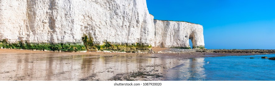 Panoramic view of white chalk cliffs and beach in Kingsgate Bay, Margate, East Kent, UK