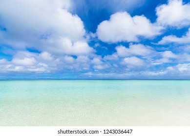 Panoramic view of white sand beach under the blue sky with white clouds