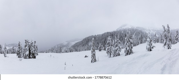 Panoramic View of the White Snow Covered Canadian Mountain Landscape during Winter. Taken in Squamish, near Vancouver, British Columbia, Canada. Nature Background Panorama