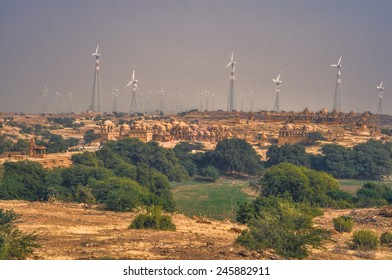 Panoramic view of wind turbines standing among bushes in Thar Desert