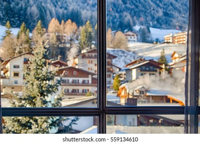 Panoramic view of winter mountain landscape with Italian village through a window