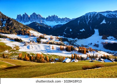 Panoramic view of winter sunny day in St. Magdalena village, Funes valley, Odle Group, Dolomiti Alps. Bolzano - South Tyrol, Italy