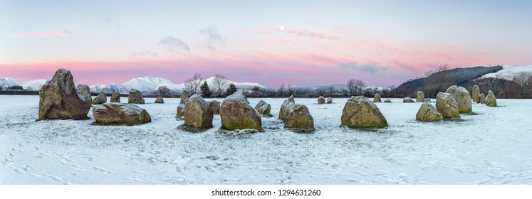 Panoramic view of winter sunrise at Castlerigg stone circle in the Lake District
