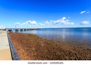 Panoramic view of the Woody Point Jetty, a 240 meters long pier in the Redcliffe Peninsula, Queensland, Australia