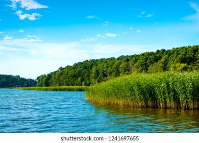 Panoramic view of Wulpinskie Lake at the Masuria Lakeland region in Poland in summer season