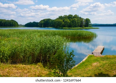 Panoramic view of Wulpinskie Lake at the Masuria Lakeland region in Poland in summer season